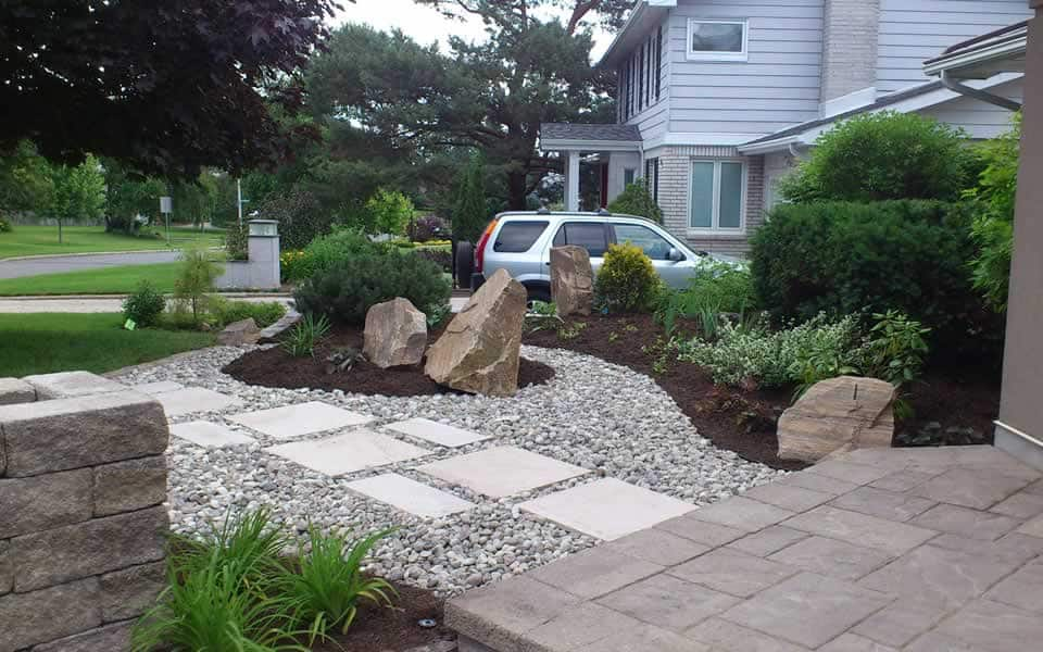 Sandstone ornament boulders and walkway revised garden beds and walkway designed by Rhonda Derue installation by Yards Unlimited Landscaping Inc.