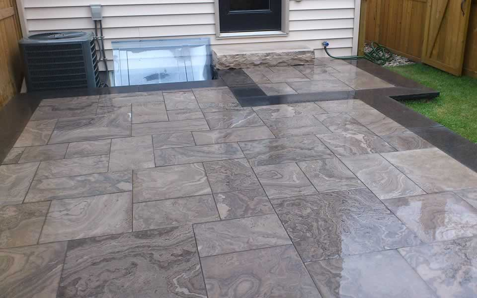 Eramosa limestone patio Asian black granite accents