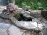 Bubbling Granite rock with small pond