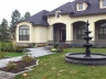 Formal front yard, slate walkway, fountain and gardens