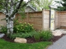 Horizontal board fence with plantings