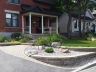 Terraced front yard with Synthetic lawn designed by Rhonda Derue, installation Yards Unlimited Landscaping, Inc | Retained levels of sloped front entrance