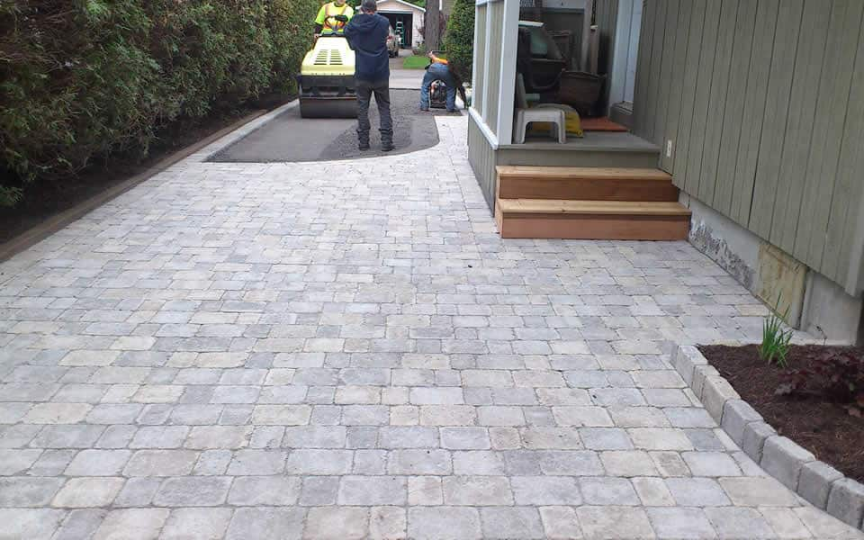 Interlock and asphalt driveway design by Rhonda Derue Installation by Yards Unlimited Landscaping Inc.
