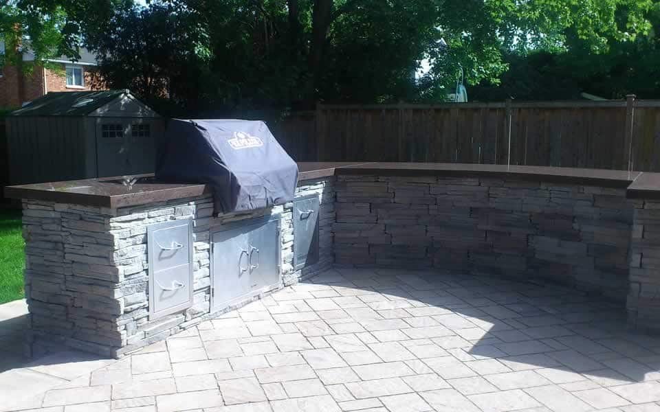 Outdoor kitchen designed by Rhonda Derue installed by Yards Unlimited Landscaping Inc.